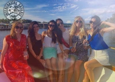 Girls-on-boat-ready-for-a-night-out-in-Orange-Beach-AL-for-Bachelorette-Party-weekend